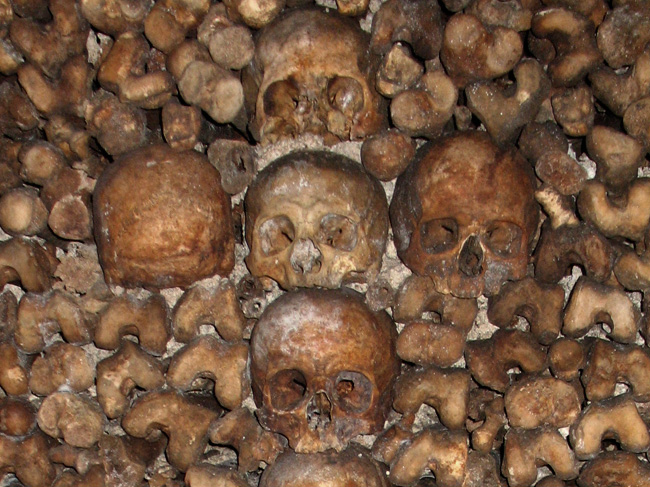 Skulls forming a cross at the top of an altar of bones in the Paris Catacombs.